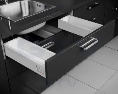 "GTV 500mm x 84mm Under Sink Modern Drawer Box System GTV 500mm x 84mm Under Sink Modern Drawer Box System Measurements Length: 500mm Height: 84mm Soft closse drawer slides Max Weight: 40 kg Colour: Grey Full cut with space either side of sink unit to accommodate plumbing Simply provide the back, front and drawer bottom to complete your drawer GTV 500mm x 84mm Under Sink Modern Drawer Box System Description Designed and manufactured by GTV this ""all in one box"" provides a simple solution for replacement or new drawers. In each box there is a set of soft close drawer runners, twin walled sides and front connectors. By simply adding a rear panel and base and utilising your existing drawer front the system is ready to install. Available in 3 different heights by way of parallel bars you can mix and match to suit your requirements. Also available to complement the range are a corner cabinet, under oven and under sink version all with built in soft close drawer runners. Accessories available to maximise your storage within the drawers include knife block, cutlery tray & foil dispenser."
